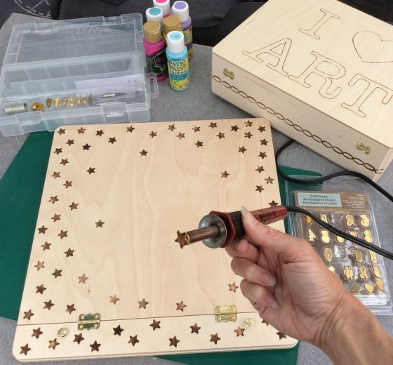 wood burn stars on wood scrapbook easel