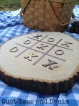 Wood burned tic tac toe board