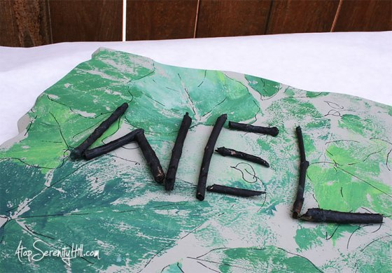 Wood Welcome Sign from Walnut Hollow using fresh leaves as a background stamp and twigs as letters! AtopSerenityHill.com