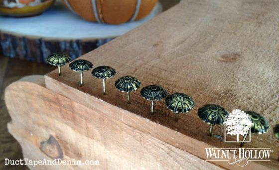 Upholstery tacks on sides of pumpkin box