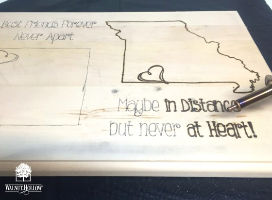 Burning the design into the Walnut Hollow state sign gift