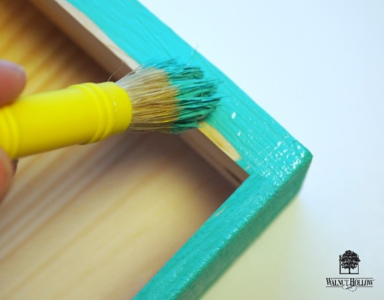 Painting a DIY Floating Book Shelf