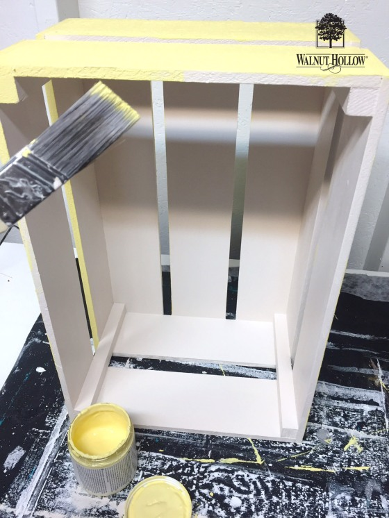 paint the rustic crate with a bright happy yellow paint