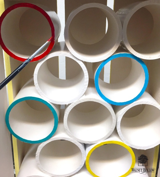 Painting the pvc pipes inside the Walnut Hollow rustic crate for the Tsum Tsum storage