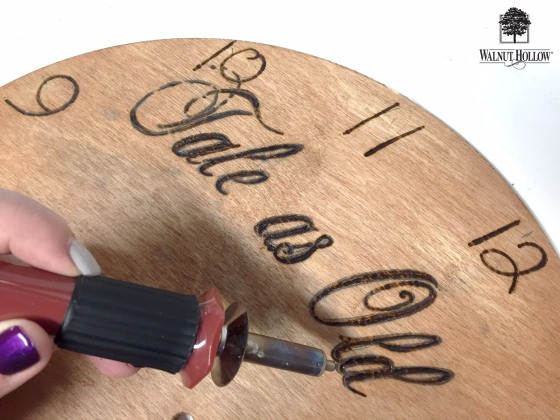 Wood burning the wedding clock surface