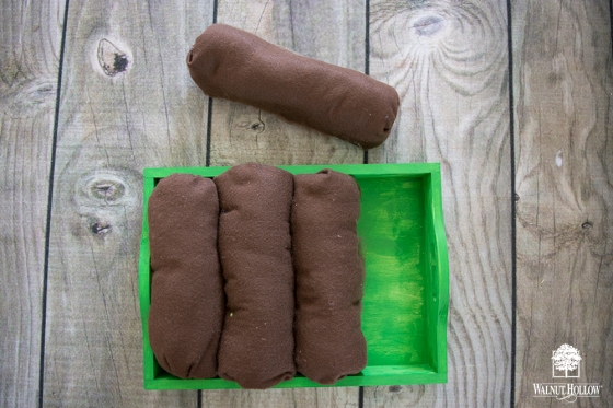felt dirt rolls in the serving tray garden