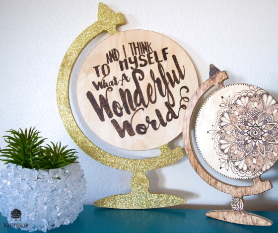wood burned globe shapes with hand lettering