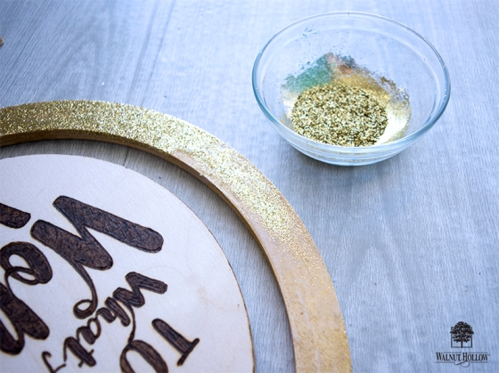 gold glittered globe stand