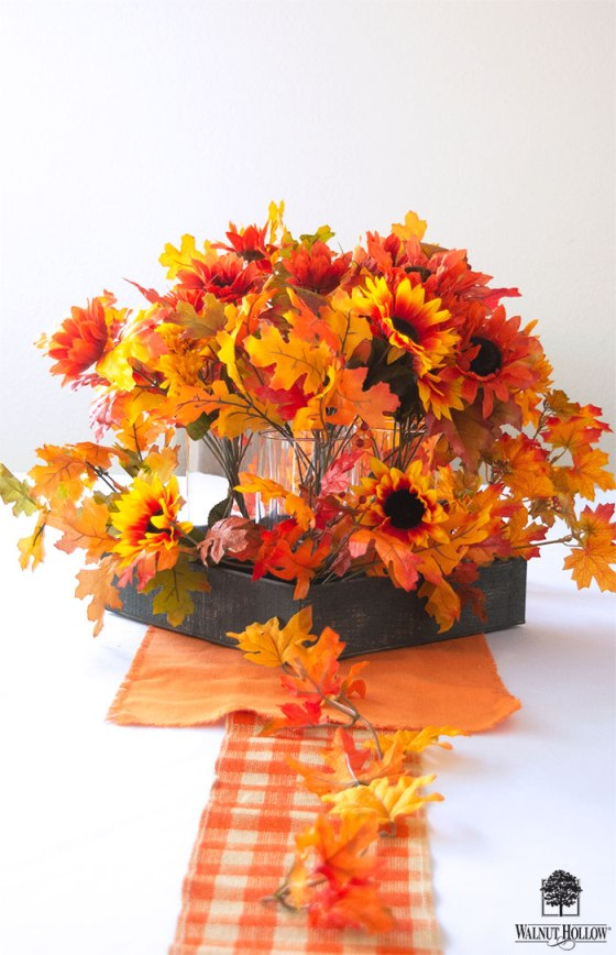 Fill the centerpiece with fall foliage