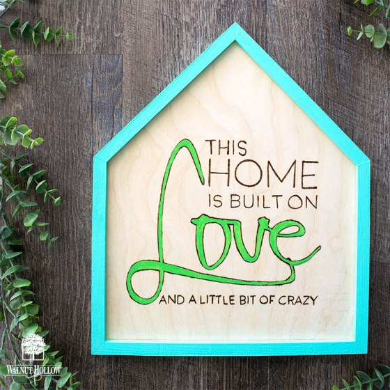 This home is built on love and a little bit of crazy hand lettered wood burned sign