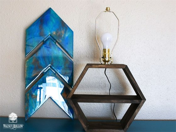 Assemble and wire your lamp kit, attach to the hexagon shelves, and add a lightbulb