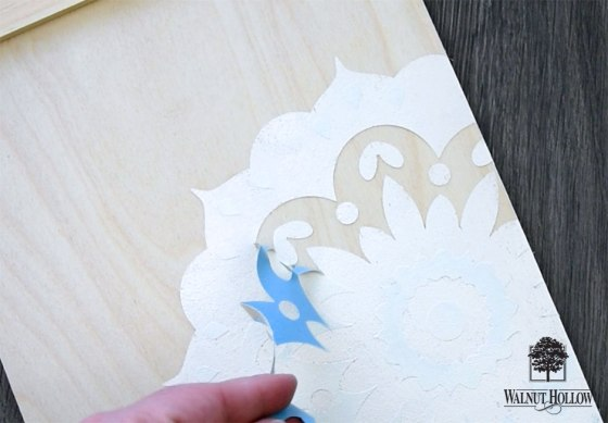 peel the stencil while the paint is still wet